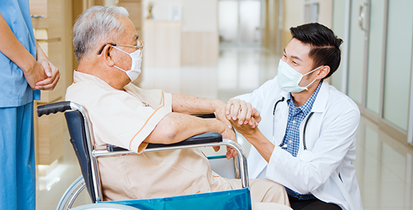 Doctor and patient speaking at the hospital